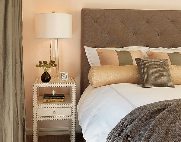 contemporary neutral colored bedroom with quilted headboard